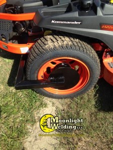 wleded wheel lock on mower by Moonlight Welding